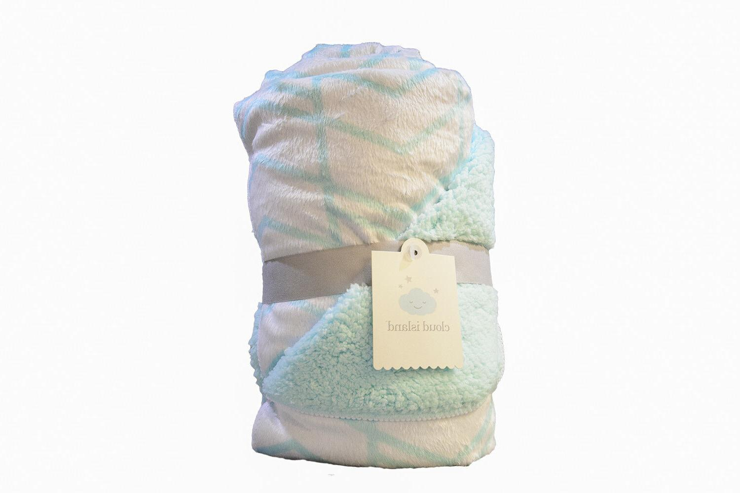 new by aqua and white plush reversible
